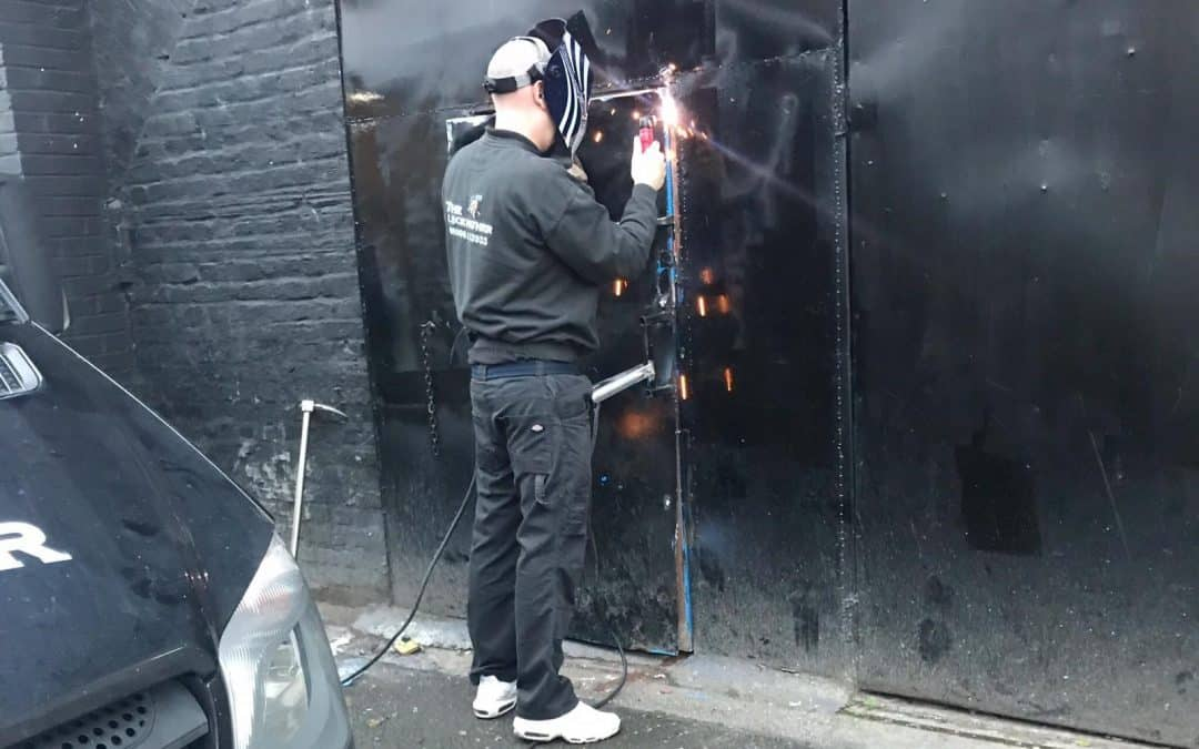 an emergency locksmith Chelmsford securing a property door using a welder
